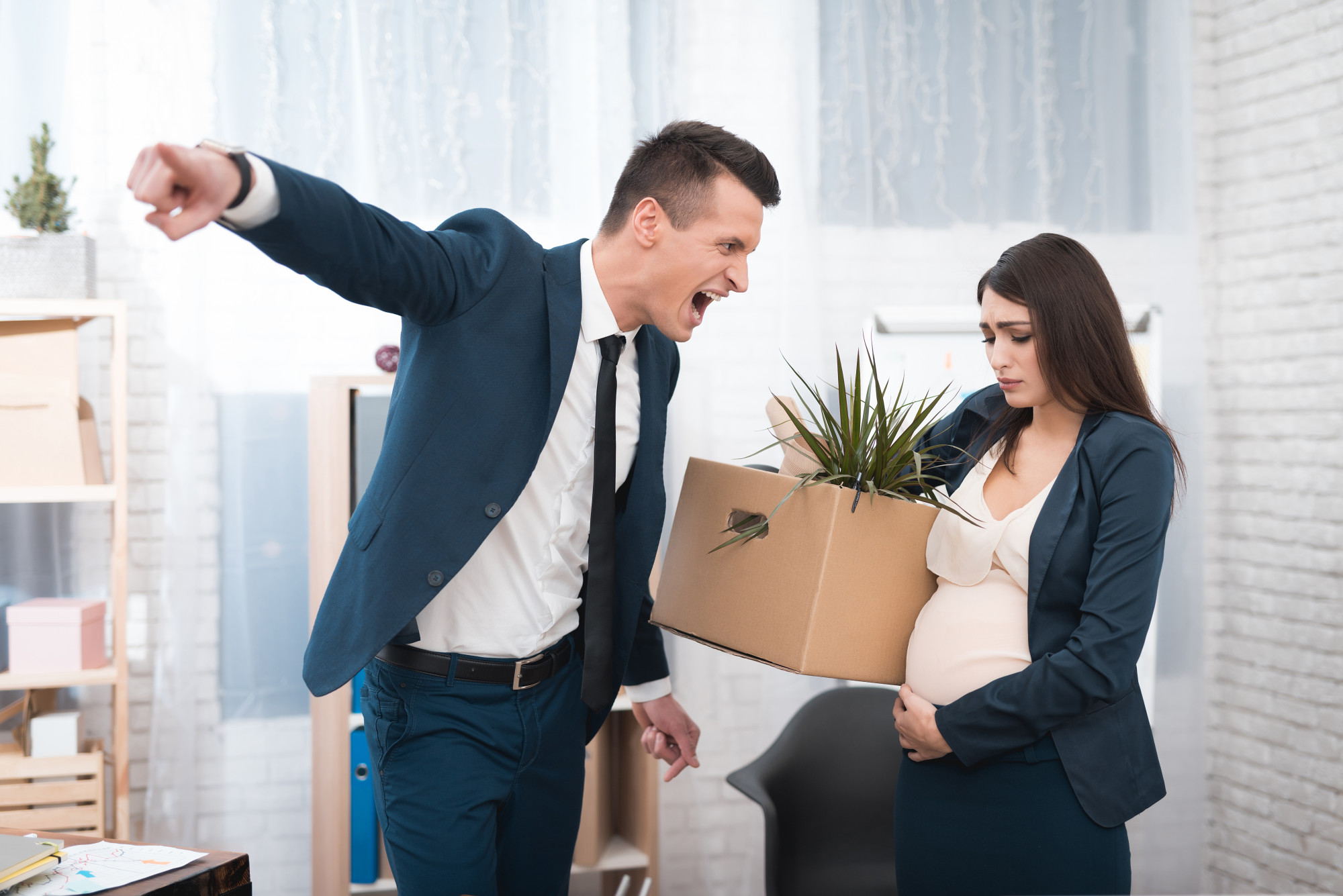 Young angry chief screams and fired upset pregnant girl with stuff box in office.