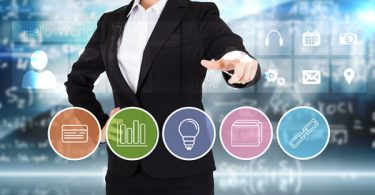 woman pointing to business apps 600x343