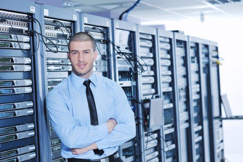 young handsome business man engeneer in datacenter server room